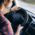 Man driving a car - interior view