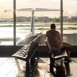 Man sitting alone in airport waiting area