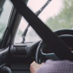 Passenger view of driver inside vehicle with misty windows
